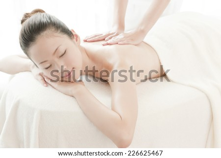 Japanese woman receiving oil massage - stock photo