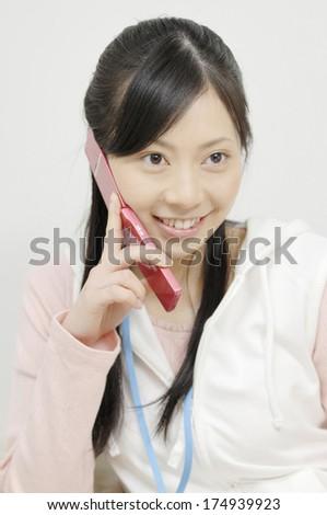 Japanese Woman talking on mobile phone - stock photo