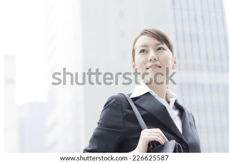 Japanese woman working in the business district - stock photo