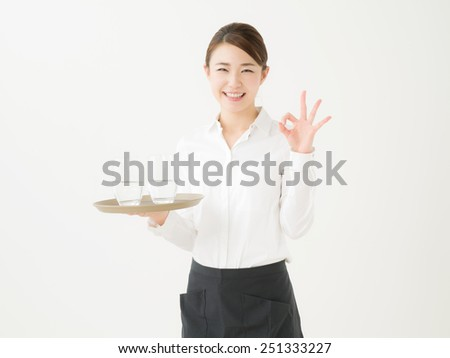 Japanese woman working part-time at a cafe - stock photo
