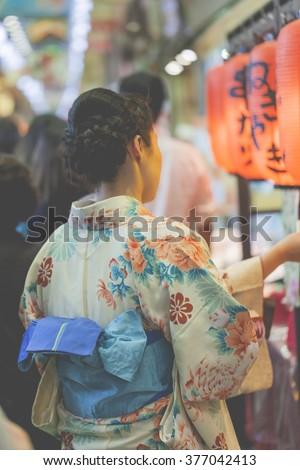 Japanese women wear a traditional dress called Kimono - stock photo