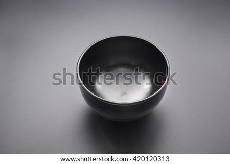 Japanese wooden black bowl on black background.                                  - stock photo