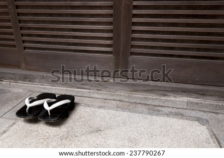 Japanese wooden traditional shoes in front of home entrance - stock photo