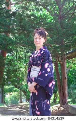 Japanese young woman in yukata - stock photo