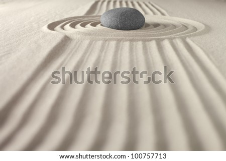 japanese zen garden rock and sand meditation pattern lines and stone stand for nature purity spirituality balance harmony concept for wellness and spa - stock photo