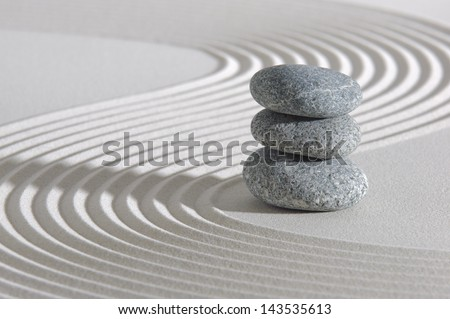 Japanese zen garden with stone in sand - stock photo