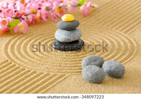 Japanese ZEN garden with textured sand and stones - stock photo