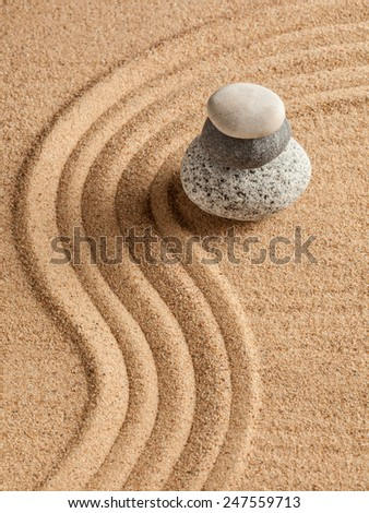 Japanese Zen stone garden - relaxation, meditation, simplicity and balance concept  - pebbles and raked sand tranquil calm scene - stock photo