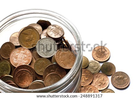 Jar filled with cash donation for charity - stock photo