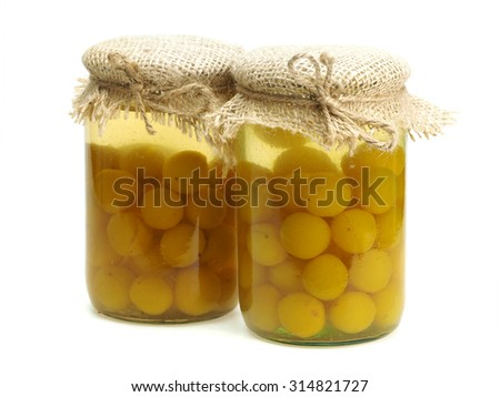 Jar of cherry plum compote on a white background      - stock photo