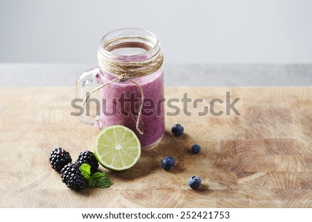 Jar of fresh homemade fruit smoothie,  studio - stock photo