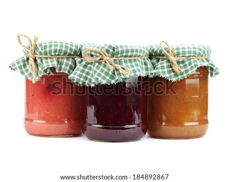 Jar of home made apple and blackberry jam on a white background      - stock photo