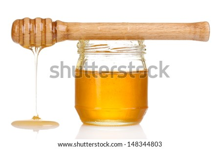 Jar of honey and wooden drizzler isolated on white - stock photo