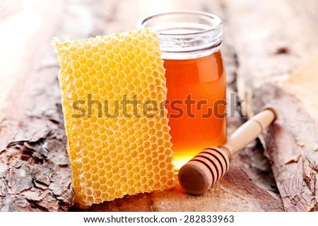 jar of honey with honey comb - food and drink - stock photo