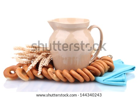 jar of milk, tasty bagels and spikelets, isolated on white - stock photo