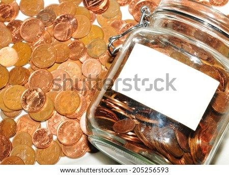 Jar of money with blank label - stock photo