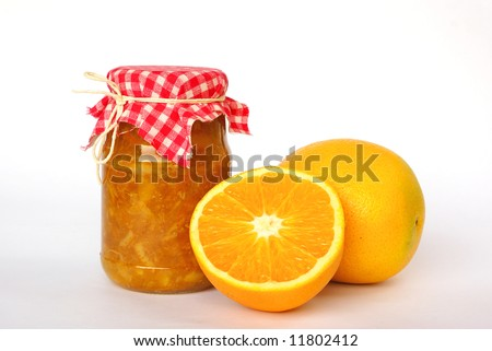Jar of orange marmalade - stock photo