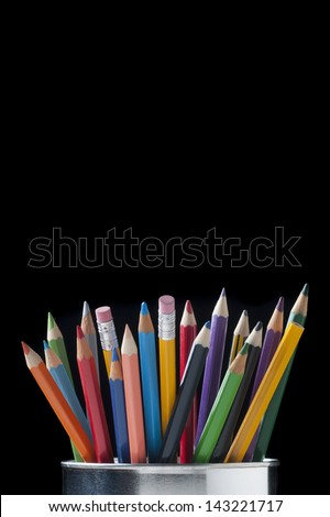 jar with a variety of different colored pencils - stock photo
