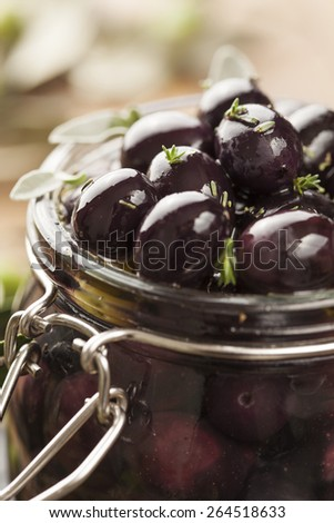 jar with pickled kalamata olives - stock photo
