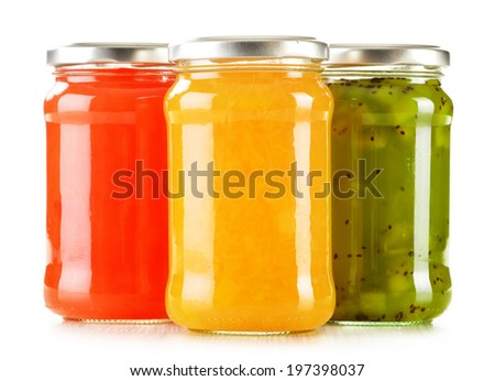 Jars of fruity jams isolated on white background. Preserved fruits - stock photo
