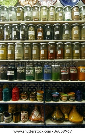 Jars of herbs and powders in a moroccan spice shop. - stock photo