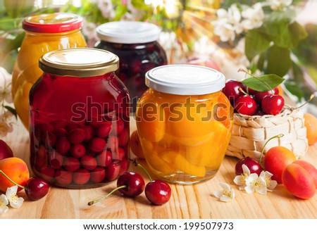 Jars of homemade fruit preserves - stock photo