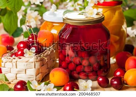 Jars of homemade fruit preserves. - stock photo