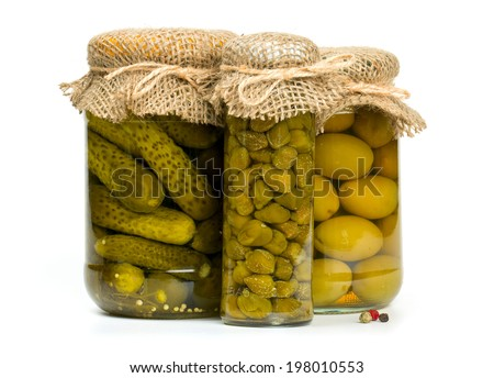 jars of pickles, capers and olives isolated on white - stock photo