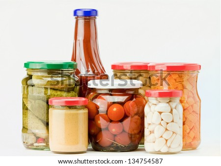 jars of preserved food isolated on white - stock photo