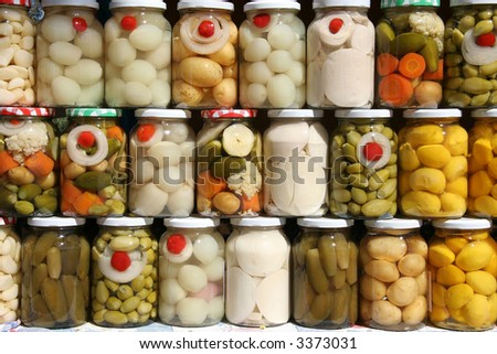Jars of traditional Brazilian vegetables from the state of Goias. - stock photo