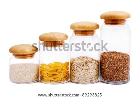Jars with different kinds of groats, macaroni, rice isolated on white - stock photo