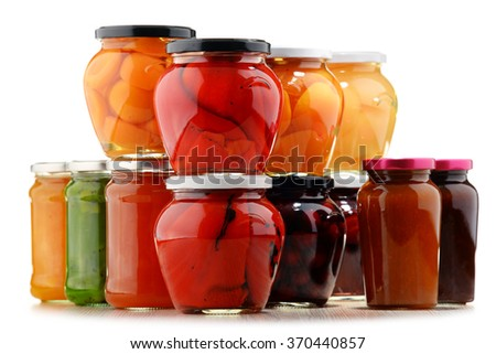 Jars with fruity compotes and jams. Preserved fruits. - stock photo