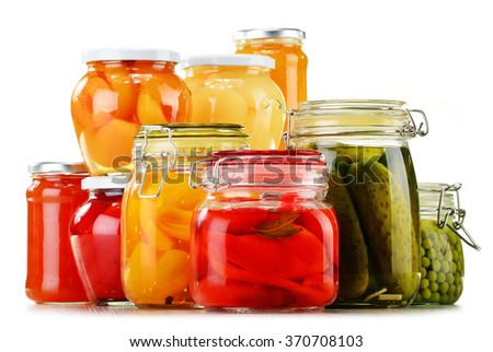Jars with pickled vegetables, fruity compotes and jams isolated on white background. Preserved food - stock photo
