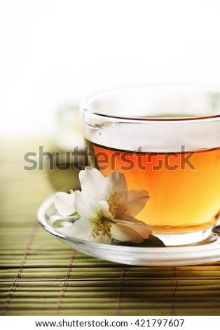 Jasmine tea cup with white background - stock photo