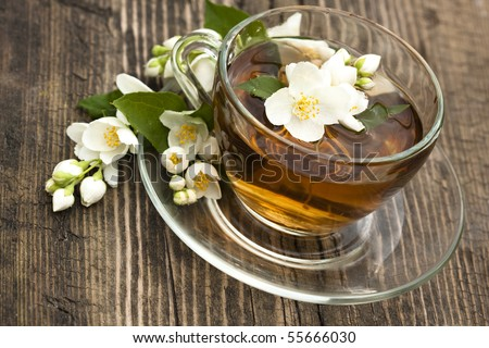 jasmine tea in a glass cup on the background of the old invoice board - stock photo