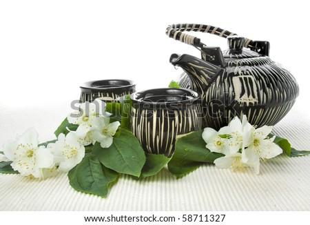 jasmine tea isolated on tablecloth isolated on white  background   - stock photo