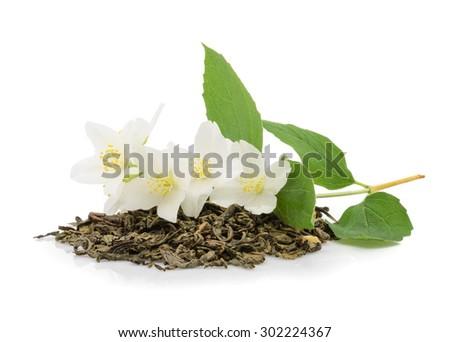 jasmine tea with jasmine flowers on white - stock photo