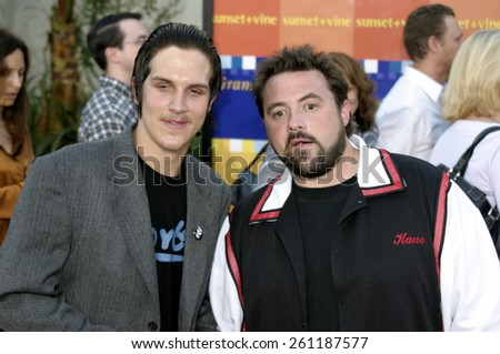 "Jason Mewes and Kevin Smith at the Los Angeles premiere of ""The Bourne Supremacy""held at the Cinerama Dome in Los Angeles, California United States on July 16, 2004. - stock photo"