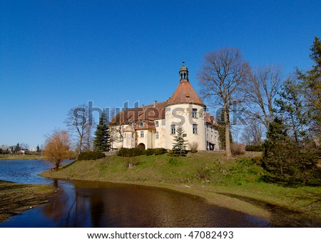 Jaunpils castle (in Latvia) was built in 1301. as Livonia Order fortress. - stock photo