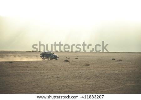 JAVA, INDONESIA - JUNE 18, 2014: Jeeps around the Mt Bromo Volcano in Java, Indonesia - stock photo