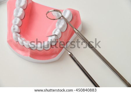 jaw model and dental tool set - stock photo