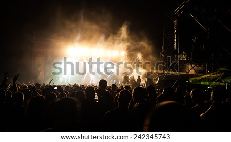 JAZ, MONTENEGRO - JULY 15: Audience infront of the Main Stage at SEA DANCE Music Festival - EXIT ADVENTURE, on July 15, 2014  at the Jaz beach near Budva, Montenegro. - stock photo