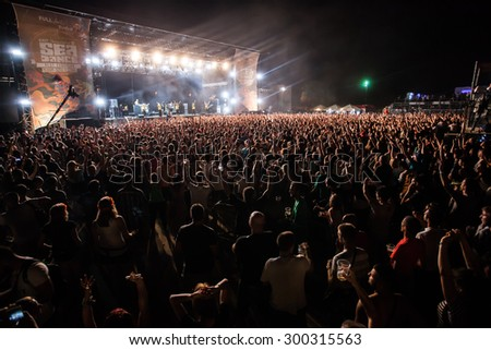 JAZ, MONTENEGRO - JULY 16 2015: Audience infront of the Main Stage during Dubioza Kolektiv's performance at SEA DANCE Music Festival, on July 16, 2015 at the Jaz beach near Budva, Montenegro. - stock photo