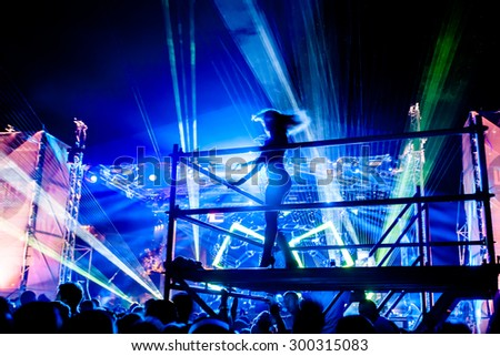JAZ, MONTENEGRO - JULY 17 2015: Female performer dances infront of the Dance Paradise stage at SEA DANCE Music Festival - EXIT ADVENTURE, on July 17, 2015 at the Jaz beach near Budva, Montenegro. - stock photo