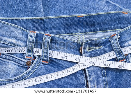 jean and scales tape - stock photo