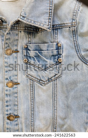 jean shirt with pocket and metal button on clothing textile industrial - stock photo