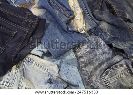 Jeans are beautifully detailed blue, dark blue and black - stock photo