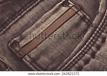 Jeans background with blank label - stock photo