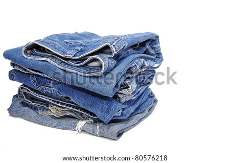 Jeans folded in a neat stack - stock photo