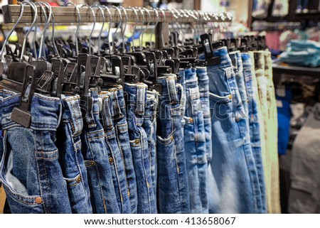 jeans hanging on display in a store - stock photo